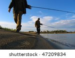 two man fishing on river - stock photo