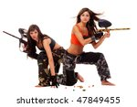 Two young beautiful girls posing like playing paintball - stock photo