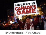 VANCOUVER, BC, CANADA - FEBRUARY 28: Canadian man celebrates Canada Hockey Team Gold Medal win at 2010 Winter Games, February 28, 2010 in Vancouver, BC, Canada - stock photo