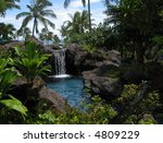 Tropical lagoon and waterfall - stock photo