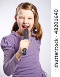 little girl singing using a hairbrush as microphone - stock photo