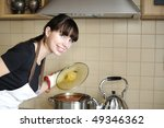 Young housewife preparing meal - stock photo