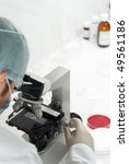 Scientist conducting genetic research of blood sample in laboratory selective focus - stock photo