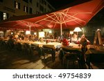 VENICE - OCTOBER 27: Al fresco dining by night at a traditional pizzeria on October 27, 2009 in Venice. Tourism here is the main source of revenue for businesses. - stock photo