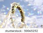 blur roller coaster ride with starburst. - stock photo