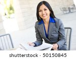 An attractive Indian business woman outside office building - stock photo