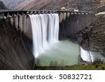 soft waterfall from the dam - stock photo