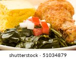 Fried Chicken served with collard greens and cornbread - stock photo
