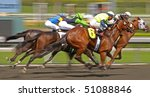 ARCADIA, CA - MAR 24: Jockeys compete in a thoroughbred maiden claiming race at Santa Anita Park on Mar 24, 2010 in Arcadia, CA. - stock photo