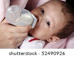 Baby boy drinking milk bottle - stock photo
