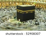 MAKKAH - APRIL 24 : A 6-second exposures of pilgrims circumabulate (tawaf) Kaaba on April 24, 2010 in Makkah, Saudi Arabia. Pilgrims circumambulate the Kaaba seven times in counterclockwise direction. - stock photo