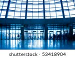 crowd silhouettes in the office centre - stock photo