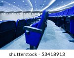 Blue chairs rows in conference hall - stock photo