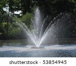 fountain in pond - stock photo