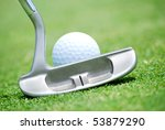 close of putter and ball - stock photo