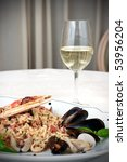 Dish of crab with wine in restaurant - stock photo