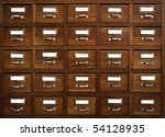 Rows of little drawers with white empty tags in an old furniture module - stock photo