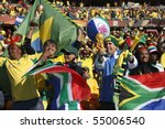 JOHANNESBURG - JUNE 5:  Bafana Bafana supporters cheer prior to the start of a World Cup match between South Africa and Mexico June 11, 2010 in Johannesburg, South Africa  EDITORIAL ONLY NO MOBILE USE - stock photo