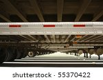 Long view under trailers - stock photo
