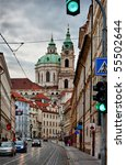 Street of Prague with baroque Saint Nicolas church - stock photo