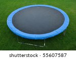 A Round Trampoline on the Back Yard Grass - stock photo