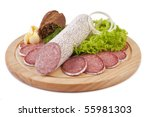 Sliced sausage with rye bread, butter and vegetables on a wooden plate isolated - stock photo