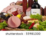 A composition of meat and vegetables with a bottle of wine isolated on white - stock photo