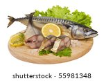 A composition with mackerel fish on wooden plate isolated on white - stock photo