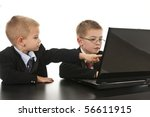 Two little boys dressed up in suits pretending to be businessmen. Isolated on white. - stock photo