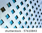 Modern office building windows with vertical lines and reflection - stock photo