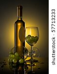 A bottle of wine, two glasses, grapes - stock photo