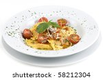 Ravioli with mozzarella cheese, cherry tomatoes and basil - stock photo