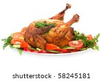 roast chicken with vegetables on a plate isolated on white - stock photo