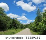 Wilderness trail in Nova Scotia. Old train line. - stock photo