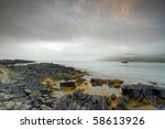 Early morning fog along the Atlantic coastline. - stock photo
