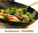 wok with stirfry - stock photo