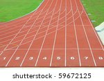 Numbered Running Tracks Of A Stadium - stock photo