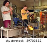 HALIFAX, CANADA - JULY 26: Glass blowers demonstrate their craft for tourists on the historic properties, a popular tourist attraction July 26, 2010 in Halifax, Nova Scotia. - stock photo