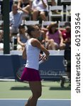 CARLSBAD, CA - AUGUST 06: Flavia Pennetta hits autographed balls to the crowd after a quarterfinal victory at the Mercury Insurance Open at La Costa Resort and Spa in Carlsbad, CA, on August 6, 2010. - stock photo