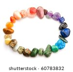 Color spectrum of semiprecious gemstones in round border, on white background - stock photo
