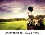 Professional golf gear on the golf field at sunset. - stock photo
