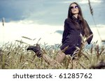 beautiful brunette girl at the field - stock photo