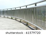 Chrome Metal Guard Rail At A Park - stock photo