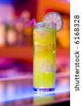 Colorful cocktail on a bar with blurry background - stock photo