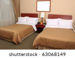 A Luxury Hotel Room with two queen beds - stock photo