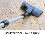 Tube cleaner on the carpet - stock photo