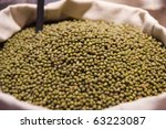 Dried green soybeans in a  bag at the greengrocer - stock photo