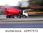 Red truck concrete mixer, panning and blur - stock photo
