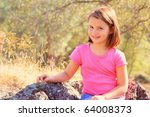 Young sitting on rocks - stock photo