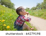 Japanese children blow bubbles - stock photo